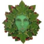 Lady Tendril Green Woman Plaque her face is surrounded by leaves and clusters of berries