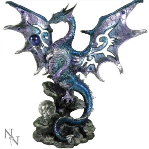 Blue Dragon Protector Figurine shows a dragon seated on a rock