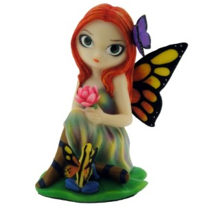 Day Dreams and Frog Fairy Figurine shows a fairy with a butterfly in her hair, even her fairy frog has wings to match hers