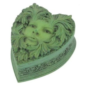 Primavera Green Lady Heart Shaped Box shows a heart-shaped box with a ladies face emerging from the leaves