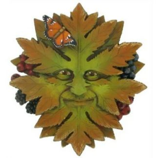 Green Nature Green Man Plaque shows his face emerging from the leaves there are also berries and a butterfly has landed on him