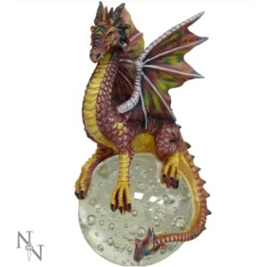 Emetine Dragon Figurine shows a dragon sitting on top of a glass globe