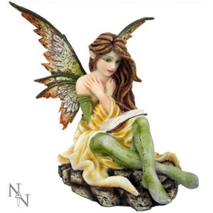 Amy Fairy Figurine shows a fairy sitting reading a book, in lovely lemon and green