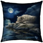The Quiet Reflection cushion shows a wolf resting by the waterside in the light of the full moon