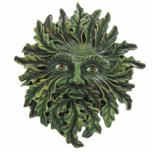 Green Man Wall Plaque Spring Green shows the face of the Green Man emerging from the foliage