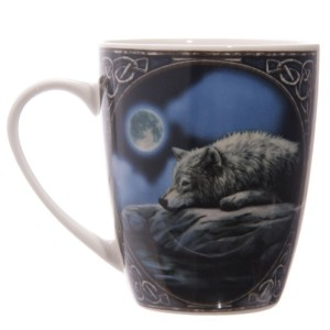 Quiet Reflection Mug shows a wolf resting by the waterside in the light of the full moon