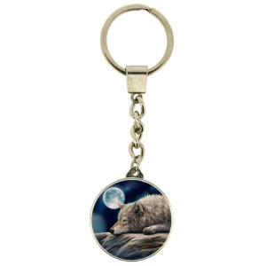 Quiet Reflection Keyring shows a wolf resting by the waterside in the light of the full moon