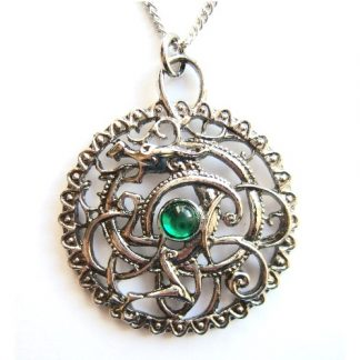 The Silbury Serpent Pendant shows a coiled dragon within a decorative circle with a green stone in the centre