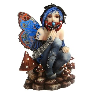 Bella Fairy Figurine shows a fairy dressed in blue and silver holding a decorative mask