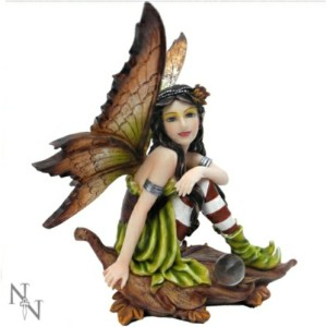 Maraliz Fairy Figurine sitting on an autumnal leaf