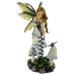 Day Dreaming Fairy Figurine shows a fairy sitting on a muchroom looking at a butterfly
